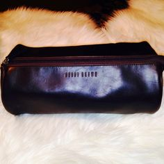 """Bobbi Brown bag  Color-Brown.   NWOT This cylinder shaped Bobbi Brown bag is so handy. It has a long zipper on the top for easy access and expansion sleeves on both sides. Super sweet bag-- many uses- make up jewelry underclothing medicine and the list goes on and on. The soft leather even has that new leather smell. . The cylinder shape is 12"""" long and the cylinder circle is 17 inches. Don't let this one get away Bobbi Brown Bags"""