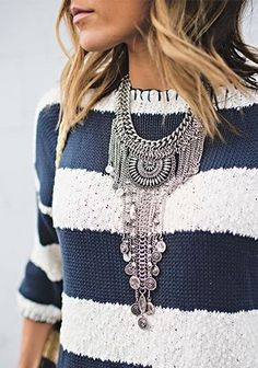 I like the weird mix of classicy stripes and this crazy necklace, which looks kind of like a waterfall