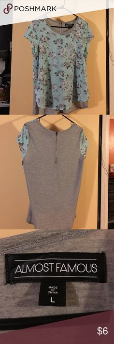 NWOT Almost Famous top, size L. Almost Famous top, size L. Only tried this on, in new condition. Has a bronze zipper in the back. Almost Famous Tops