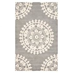 Hand-tufted New Zealand wool rug with grey and ivory medallion motif.Product: Rug  Construction Material: Wool  Color: Grey and ivory  Features: Hand-tufted  Made in IndiaMedallion motif Note: Please be aware that actual colors may vary from those shown on your screen. Accent rugs may also not show the entire pattern that the corresponding area rugs have.