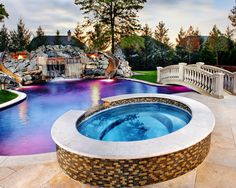 Pool slides, a hot tub, a pool bridge and gorgeous lights. I love it.