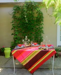 """In Provence the fabric vendors at all the markets at this time of year put their big beautiful bolts of """"Basque Stripe"""" cottons up . Gateau Basque Recipe, Provence, Gypsy Home, Cherry Tart, Outdoor Rooms, Big And Beautiful, Chic, Stripes, Table Decorations"""