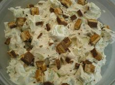 Snickers Salad  Ingredients 1 (8 ounce) packages cream cheese, softened 1 cup powdered sugar... 1 (12 ounce) containers Cool Whip, thawed 6 Snickers candy bars 4 -6 granny smith apples ( you can vary the apple with successful results if you choose to, but I would NOT recommend a soft va) Directions Mix cream cheese and powdered sugar until thoroughly blended. Fold in Cool Whip. Cut Snickers into bite size chunks and add to cream cheese mixture. Chop the apples into chunks and stir. Chill 1 ...