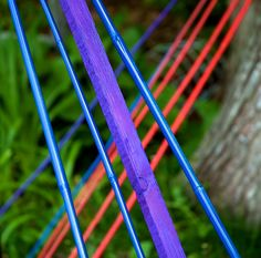 paint bamboo for color in the garden--use for stakes, trellises, or tomato cages