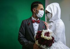 Gaza Strip Palestinian groom Mohamed abu Daga and his bride Israa at their studio photoshoot before their wedding ceremony in Khan Yunis Photograph: Said Khatib/AFP via Getty Images Bangkok, Royal Thai Army, New York City, Drive In Cinema, Times Square, Staten Island Ferry, Lights Artist, Sign Of The Cross, Gaza Strip