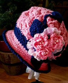 Your little special lady will look charming in this beautiful handcrafted Crocheted Hat! Every flower, petal and bow is hand made with care. The unique combination of colors will add the final touch of elegance to your little girls outfit! This hat will fit your 3 to 5 year old. It will be perfect for Church and other special outings