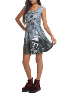 Tank style dress from Alice in Wonderland with a Gothic style Alice falling design. 92% polyester; 8% spandex Wash cold; dry low Imported