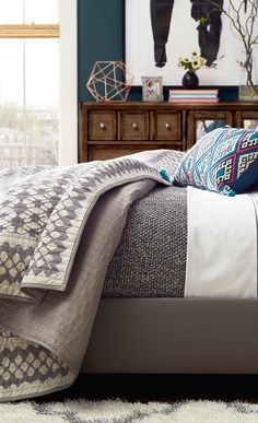 Add a pop of pattern to your master suite or guest room with this quilted cotton quilt, showcasing a geometric trellis design in gray. Accessorize your bedroom at jossandmain.com