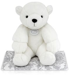 Gabriel the bear gently watches over small children as they sleep. With its 'Dior' signature label, this large 100% polyester polar bear with cotton stuffing is suitable from birth.