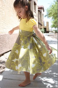 DIY Tee-shirt Twirly dress. (You sew the skirt and sash onto the shirt.) Would be great to use the Tees that are too short on my tall girl!