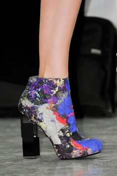 These ankle boots' heel is what makes something that woulda been girly, much more edgy. Impressive.
