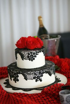 absolutely BEAUTIFUL!!! White Cake with Black Lace and Red Flower Toppers