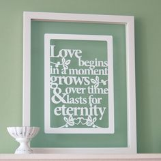 Personalized Papercut 'Love begins in a moment' art / picture. £25.00, via Etsy.