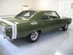 ...Looks like an Army green. Love it! HOOAH!... 1968 dodge dart gts