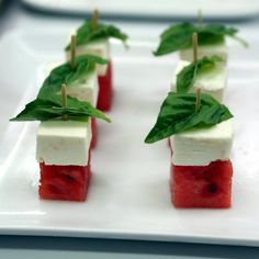 Watermelon Feta Bites  These easy appetizers look impressive, but take just 10 minutes to put together. Salty feta is paired with light, juicy watermelon and fresh basil, then finished off with a drizzle of balsamic vinegar. Stacking the cubes and pressing in the toothpick is the perfect task to assign little kitchen helpers!