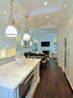 Prestige Mouldings & Construction: Beautiful kitchen with recessed lighting in coffered ceiling as well as dark stained ...