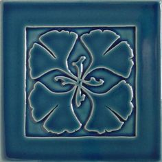 """Ginkgo tile in gloss blue. Art Tiles. $36 each. Art Tiles may be used in combination with our border designs and field tiles. Please go to our Architectural Tiles and Project Gallery pages for examples and more information. Tiles are approximately 5 7/8"""" sq. and 9/16"""" thick.    All tiles are available in any of the glazes."""
