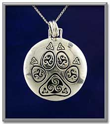 "Celtic Pawprint Pendant - Summon your animal guides, and heed their wisdom. This unusual pawprint has Celtic triskels on each pad, tipped with tiny Celtic knots. Slightly domed, and polished to a mirror finish, this sterling silver pendant measures 1 1/8"" in diameter, and comes with an 18"" sterling chain."
