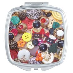 A collection of unique buttons including two red plaid Scottie dogs, buttons with red faux gems, metal buttons and novelty buttons. Perfect gift for a button collector or button lover. Quite handy to ladies to carry in their purse.  Plaid Scottie Dog Buttons.