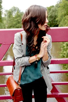 grey blazer, teal top, black jeans