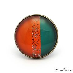 Trendy ring - Green and Orange - The #jewelry of the day! More info at misscabochon.com
