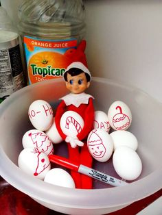 Our Elf on the Shelf decided to decorate the Eggs in the Fridge. He seems to think he's the Easter Bunny today...