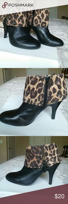 Nine West booties Almost 4 inches tall booties with animal print and zipper on both sides. Textile/leather upper. Nine West Shoes Ankle Boots & Booties