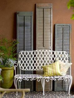 Vintage shutters are perfect for creating a rustic old world design.....