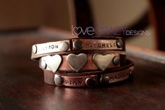 My new favorite!! Wrap around bracelet with kiddos names and a heart for each kiddo! rdmccune