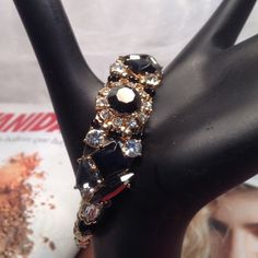 Rhinestone Cuff/Host Pick Statement bracelet, this gold tone sturdy cuff features black and clear clusters of rhinestones and Is adjustable. Simply gorgeous! (This closet does not trade) Boutique Jewelry Bracelets