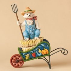 Fall/Autumn I love this one Country Living-Farm Cat On Wagon Figurine