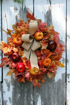 Fall (Thanksgiving Wreath): Fall Wreath, with faux Apples, Leaves, and a Burlap Bow. Easily DIY, though it's also for sale at Etsy.