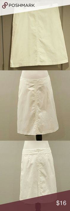 """Banana Republic White Skirt White cotton skirt by Banana Republic. Slight aline style with stretch added for comfort. Top stitching detailed seam adds interest down the front. Length falls below the knee. Has side pockets!!! Lined.  Very good pre-owned condition.   92% cotton, 8% spandex shell. 100% acetate lining. Dry clean.  Approx. 22.5"""" length, 17"""" across waistband Banana Republic Skirts"""