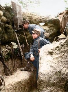 French soldiers using a periscope inside a trench, 1915