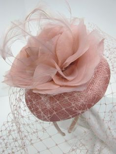 A pretty dusky nude pink pill box hat fascinator with fabric flower, feathers and birdcage veil with a hairband fitting. Sinamay Hats, Pillbox Hat, Fascinator Hats, Fascinators, Headpieces, Pale Pink Fascinator, Cocktail Hat, Fancy Hats, Pink Hat