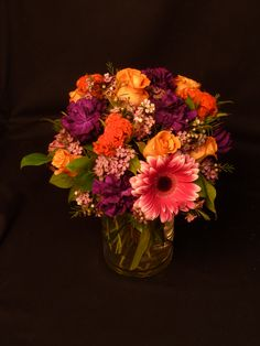 Pink gerbera daisies, orange roses with orange coxcomb and accents of waxflower.  To view our entire selection please visit us at www.starflor.com #flowers #events #eventdecor
