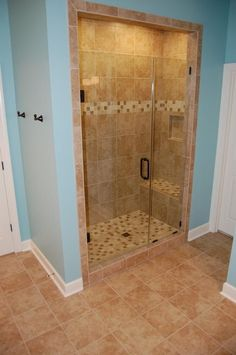 Tile shower with glass door. use of the same tile with trim and floor looks nice by patty