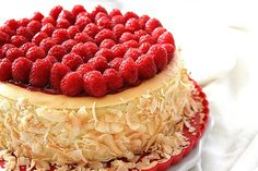 Coconut cheesecake with Raspberry gelee and fresh raspberries. Looks so tasty. Her blog is great.