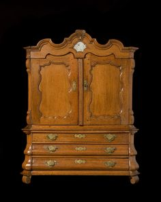 "Apprentice oak armoire with 3 lower bombe drawers. Inside has 3 drawers and 2 hidden drawers. Brass mounts. Holland circa 1800. Height 34.5"" Width 27"" Depth 9"""
