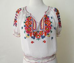 Adorable 1950's Peasant  Blouse with hand Embroidery and hand smocking and bold…