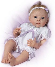 """Today we are showcasing the beautiful """"Chloe"""" from Ashton Drake Reborns.  Linda Murray is the supremely talented designer of this little beauty.  This reborn girl is a lovely little bundle of joy and makes for an excellent addition to any collection.  She can actually respond to your touch which is not something we normally see but may be a nice add-on depending on your preference.  Find out more by CLICKING HERE. Reborn Baby Girl, Newborn Baby Dolls, Reborn Toddler, Reborn Babies, Reborn Dolls Uk, Cheap Reborn Baby Dolls, Ashton Drake, Baby Discount, Wiedergeborene Babys"""