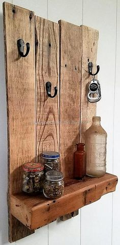 If the person wants to hang the things used in the kitchen like the apron, then the long pallets can be attached to increase the space under the hooks to make it easy to hang the apron. The reclaimed wood pallet shelf allows placing the decorative items in the kitchen as well.