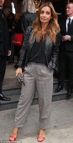 Stylish: Meanwhile Louise, 42, turned heads in striking checked trousers and a sleek leather jacket