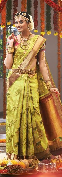 Traditional Southern Indian bride wearing bridal saree, jewellery and makeup. Tamil bride