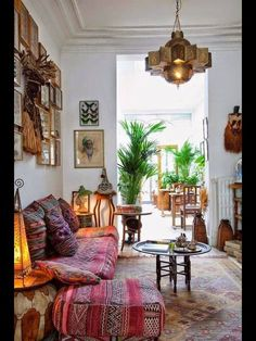 love the moroccan style light and all the mixtures of rugs and cushions