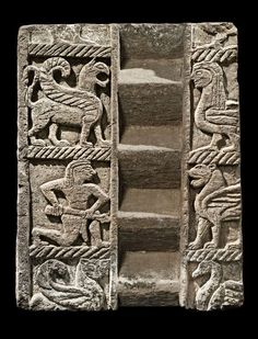 """Etruscan carved stone plaque, 550-525 B.C. The main panel is decorated with the central """"a scala"""" pattern, flanked, on the left and right, by square metopes that are adorned with orientalizing motifs carved in low relief. It shows, in this order, a winged griffin, a mermaid, a running warrior, a winged lion, a crouching winged panther turning its head towards the viewer and a swan, 70 cm high. Private collection"""