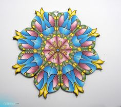 Polymer clay MANDALA by Yonat Dascalu, via Flickr.  OMG She's really good! here are a few tutorials around showing how she does these complicated canes and projects. I kinda don't think they would de ME much good!