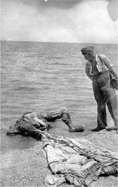 """This dead German paratrooper belonged to the Luftlande Sturm Regiment. He landed in the sea and drowned. He then later came drifting to the beach of Maleme."" Invasion of Crete, 1941."