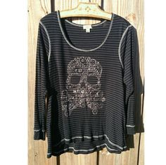Studded skull & crossbones swing top Feeling a little goth, but still want a fashionable top? NWOT really nice swing style grey and black with metal studding. Excellent condition.  Sorry no trades. ONE WORLD Tops