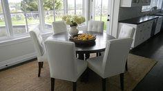 dark table + white chairs
